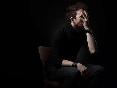 Man thinking on a black background