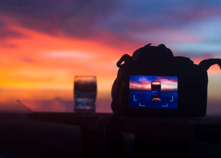 DSLR camera focusing on a water glass