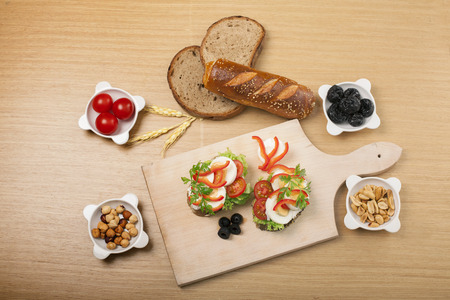 Arrangement of different types of healthy and organic food on the wooden board and wooden background. Banco de Imagens