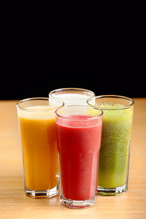 Healthy juices on the wooden table Banco de Imagens - 42466656