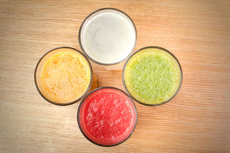 cleanse: Healthy juices on the wooden table Stock Photo