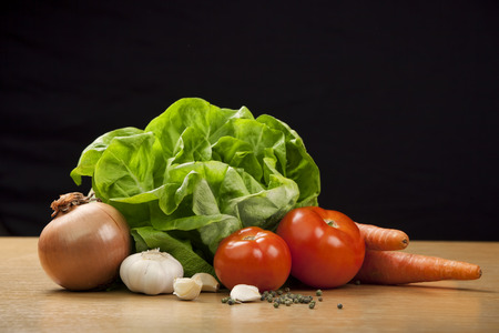 Fresh vegetables on the table with black background