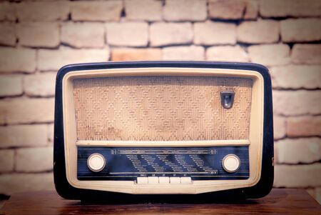 Old radio with brick wall in the background