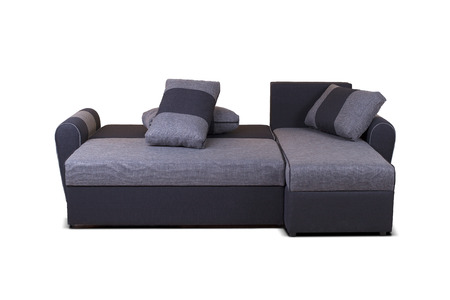 Studio shot of a grey modern sofa isolated on white background unknown model