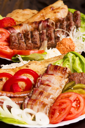 Mouth Watering Gourmet Barbecue on Wooden Table. Banco de Imagens - 43464615