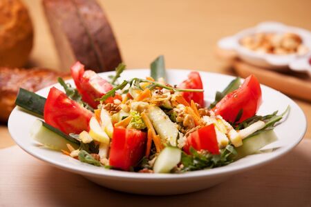Fresh vegetable salad with bread slices in the background Banco de Imagens - 43696749