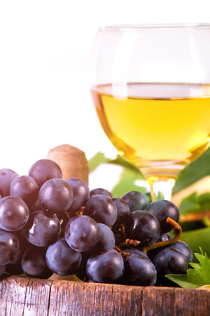 White wine set with grapes and traditional bottle on the barrel, isolated on white. Banco de Imagens - 43696773