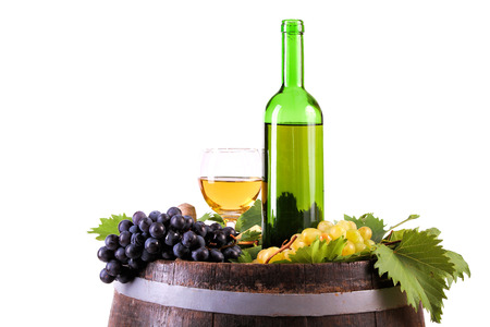 White wine set with grapes and traditional bottle on the barrel, isolated on white. Banco de Imagens - 43696774