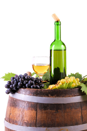 White wine set with grapes and traditional bottle on the barrel, isolated on white. Banco de Imagens