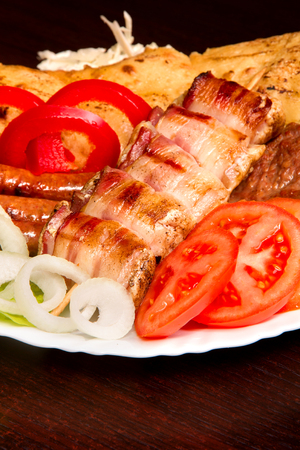 Assorted delicious grilled meat with vegetable. Banco de Imagens - 43696935