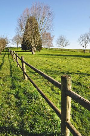 restricting: Wooden fence restricting access to a garden in the countryside