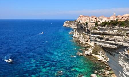 atop: Village perched atop a limestone cliff on the Mediterranean coast (Bonifacio)