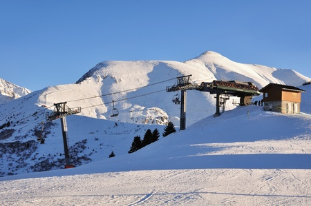 facilitate:   Arrival of lifts to mountain snow under a blue sky Stock Photo