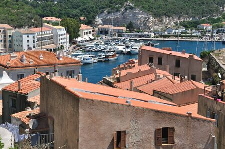 boater: marina in the hollow of a bay surrounded by houses and buildings  Stock Photo