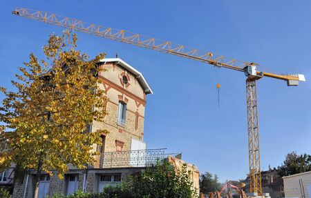 immovable:   Crane on a construction site in town