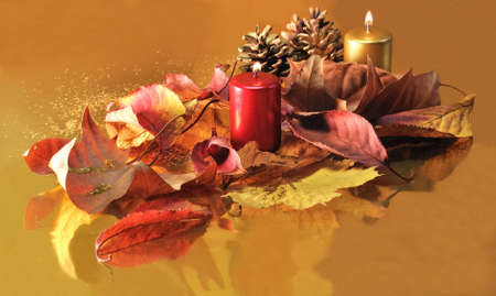 Red and golden candles  with leaves and pine cones on a golden background Stock Photo - 11557871