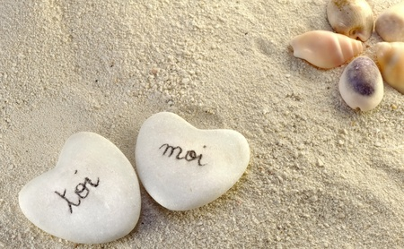 you and me hearts of pebbles in the sand photo