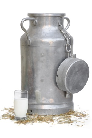old milk can and a glass of milk in front