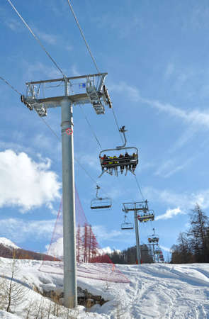 chairlifts carrying skiers to the slopes photo