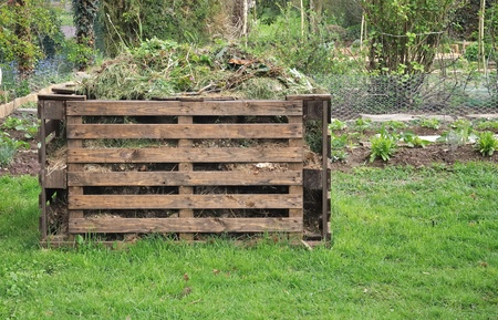 wooden composter for organic waste in a garden 写真素材