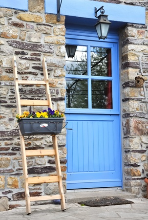 entered: blue glazed door entered a Breton home
