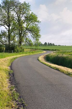 winding road through the green countryside  photo