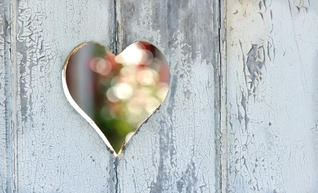 a heart pierced with a door on the peeling paint