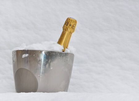 champagne bucket with bottle in the snow