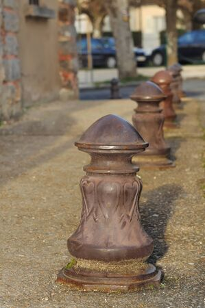 bollards: old metal bollards on city sidewalk