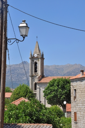 church and light of a village in Corsica (zonza) photo