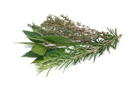 bunch of herbs composed of rosemary, thyme and bay leaves isolated on white background Stock Photo