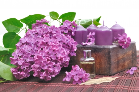 decorated with flowers of lilac purple, candles and oil to unwind