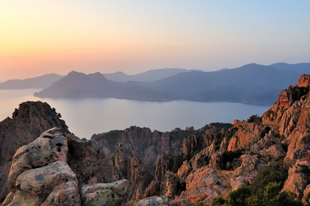 beautiful sunset on the orange cliffs of a gulf  in Corsica photo