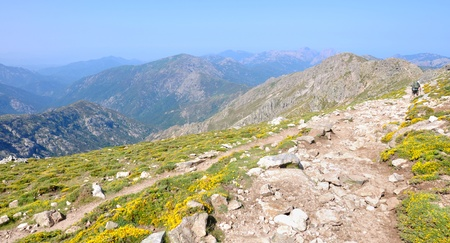 gr: rocky trail GR 20 in Corsica through the mountain Stock Photo