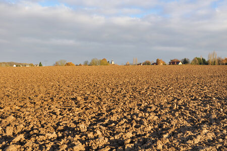 tillage: land of a freshly plowed by a sunny fall day  Stock Photo