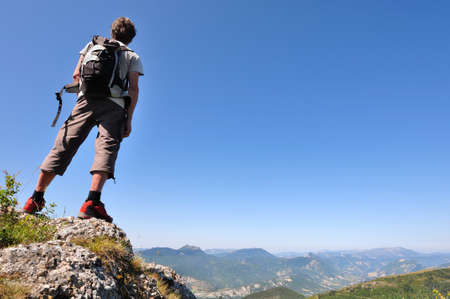 Hiker overlooking the mountains and contemplating the landscape
