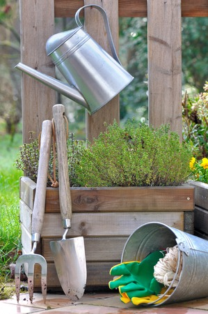Tools And Garden Accessories Against A Wooden Container On Terrace Stock  Photo, Picture And Royalty Free Image. Image 26508520.