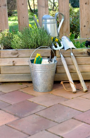 gardening tools and accessories on floor for maintenance the planters  photo