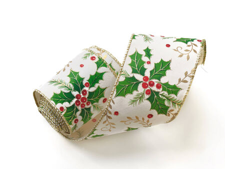 christmas motif: Fabric ribbon with holly motif for Christmas decoration on white background holidays