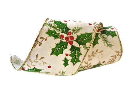 christmas motif: fabric ribbon with holly motif for Christmas decoration on white background