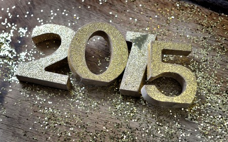 untidy: 2015 golden figures untidy on wooden and glitters background