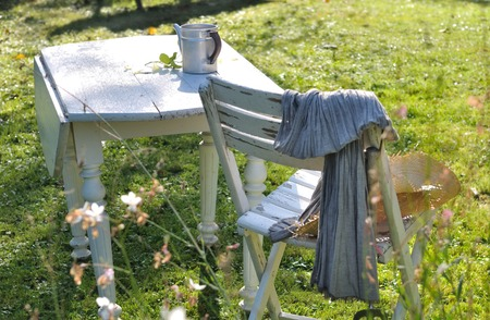 garden furniture: Wooden garden furniture in the grass of a garden in the countryside