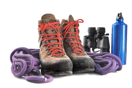 hiking shoes: hiking shoes, rope,binoculars and water bottle on white background