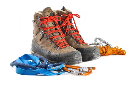 hiking shoes and mountaineering equipment on white background