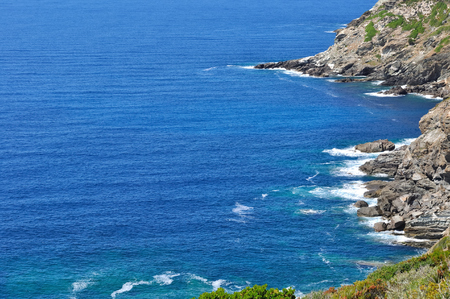 swell: billowy blue sea on the wild coasts of Cap Corse Stock Photo