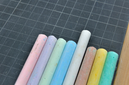 chalks: colored chalks on black slate with gridlines