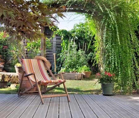 lounge chair on wooden terrace garden Standard-Bild