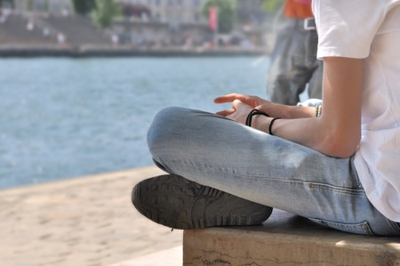 crosslegged: boy sitting cross-legged beside the Seine - Paris
