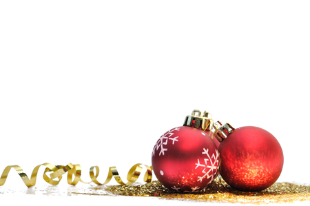 christmas gold: Red christmas balls and gold glitter on white background