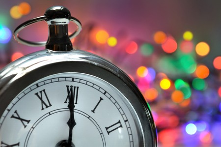 midnight: midnight on a clock with a colorful bokeh background Stock Photo